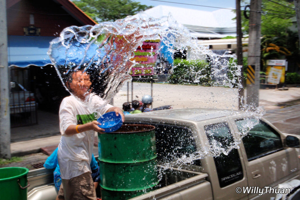 Locals prefer the simple way! A barrel full of iced water on the back of a pickup truck