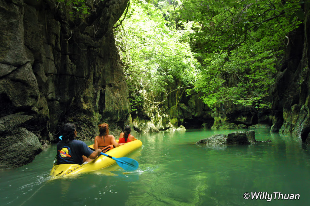 Sea canoe gliding silently in Phang Nga Bay