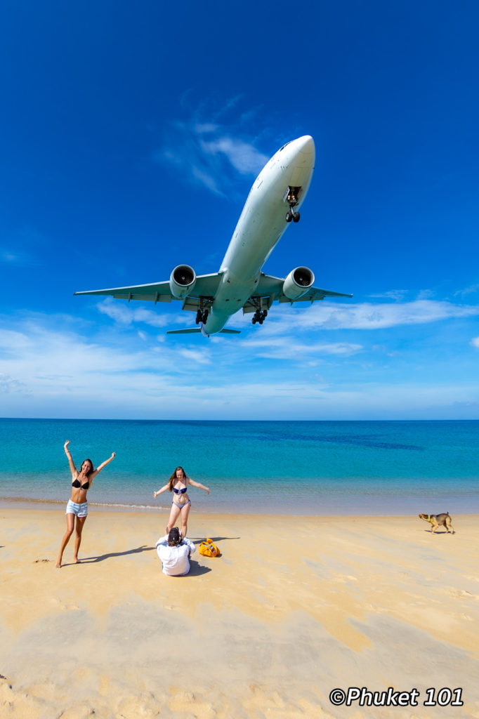 Plane landing over the beach at Phuket Airport